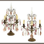 A pair of Louis XV style patinated metal and glass four light girandoles