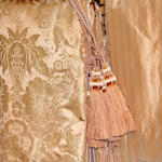 A group of apricot damask silk drapes