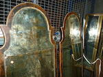 A fine pair of Queen Anne parcel gilt walnut etched pier mirrors<BR />early 18th century