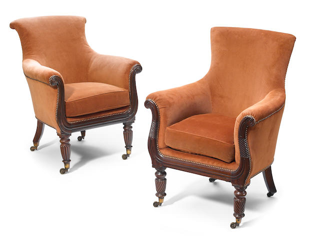 Two William VI carved rosewood upholstered armchairs