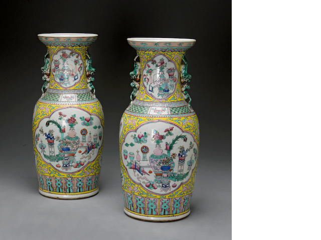A pair of yellow ground porcelain vases with famille rose enamel decoration Late Qing