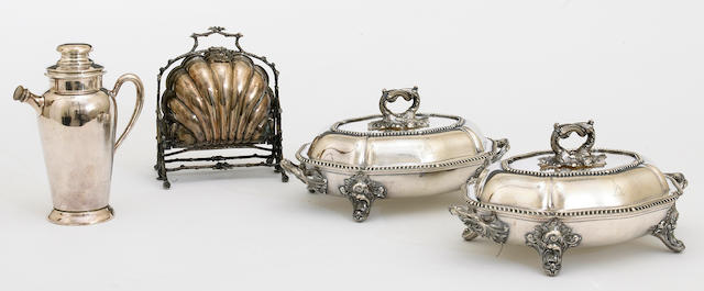 A Sheffield plate pair of entree dishes with covers and warming stands 2nd quarter, 19th century <BR />With crest