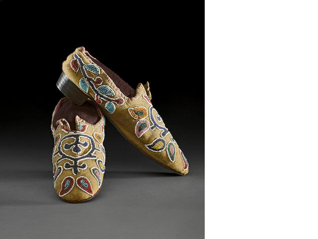 A rare and unusual pair of Dakota/Eastern Sioux  beaded moccasins