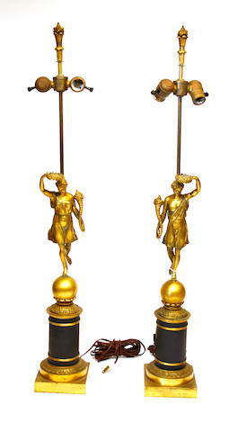 A pair of Empire style gilt and patinated bronze figural standards, now as lamps late 19th century