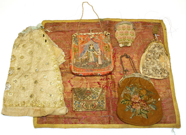An assembled group of Continental purses and fabrics 17th through early 20th century