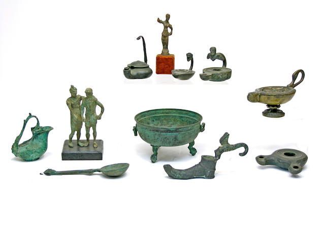 An assembled group of eleven Italian Grand Tour patinated bronze articles 19th century