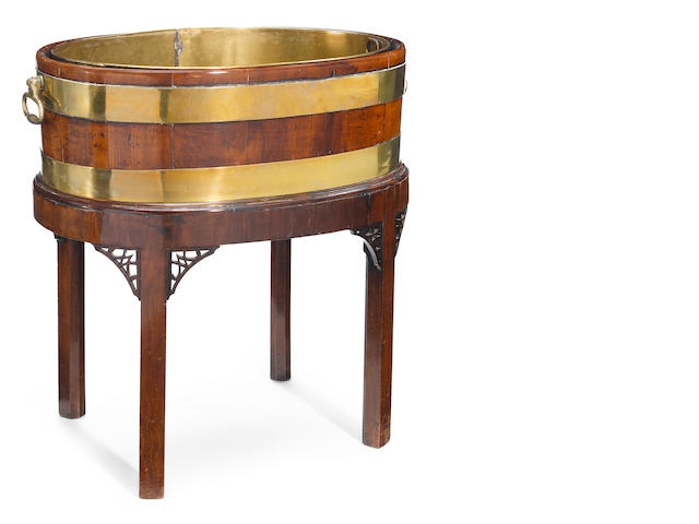 A George III mahogany and brass banded wine cooler on stand with liner <BR />late 18th century