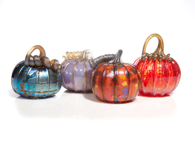 John F. Glass (American, active early 21st century) A group of four art glass pumpkins