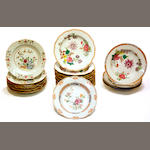 An assembled group of twenty four Chinese export porcelain famille rose decorated plates late 18th/early 19th century
