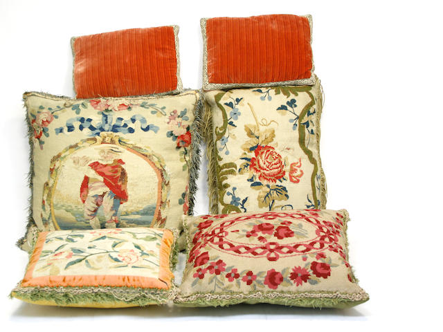 An assembled group of eleven tapestry or silk pillows