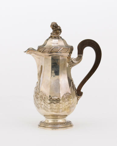 A French 950 standard silver ewer with wooden handle in the Louis XV taste  by Auger, Paris