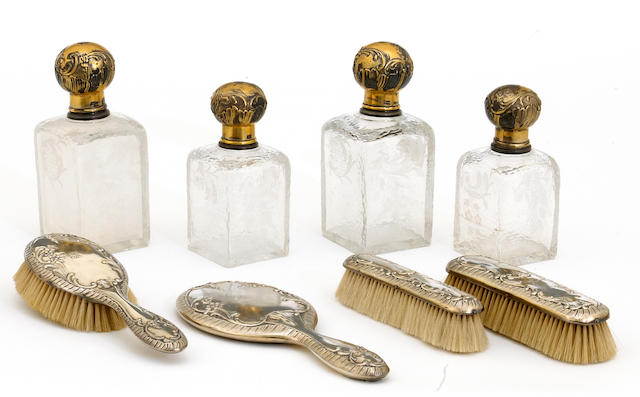 A French cut and engraved glass with chased silver-gilt mounts set of two graduated pairs of ladies' toilet bottles by Henri Ofti, Paris, circa 1900 <BR />monogrammed  (8)