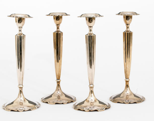 A sterling set of four weighted candlesticks by Shreve & Co., San Francisco, CA <BR /># 7159