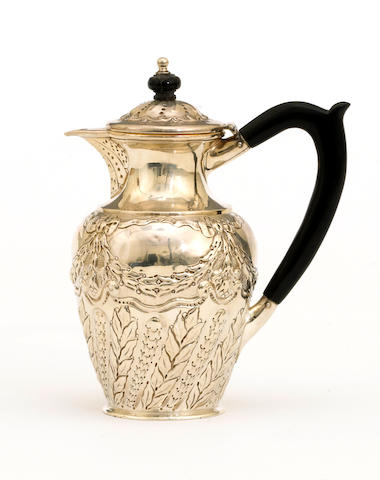 A late Victorian silver hot water jug with chased decoration and wooden fittings by Charles Edwards, London, 1897  # 830