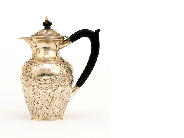 A late Victorian silver hot water jug with chased decoration and wooden fittings by Charles Edwards, London, 1897 <BR /># 830