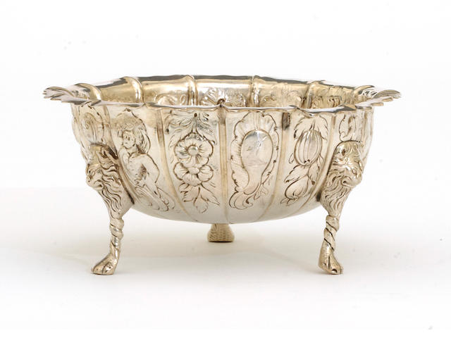An Irish George II silver tripod bowl with variant chased panel decoration without maker's mark, Dublin, mid 18th century <BR />With crest