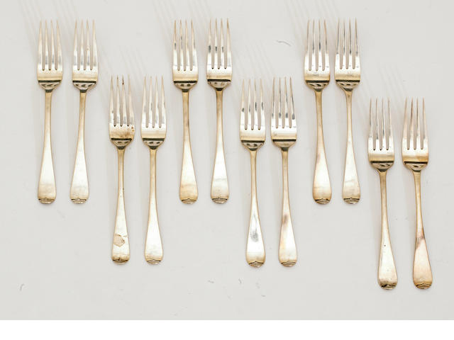 An Irish George IV silver set of twelve table forks by J. Brady, Dublin, 1827 <BR />Old English, with crest on verso