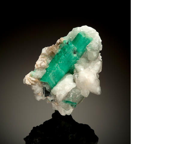 Emerald on calcite matrix
