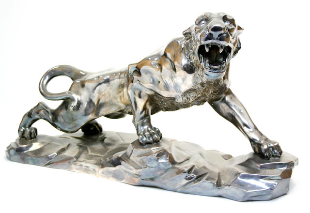 A silver plated figure of a panther