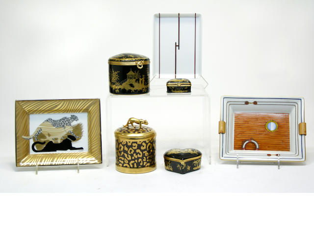 Grouping of porcelain table articles, comprising Cartier panther motif ashtray and four Limoges table boxes and two Hermes porcelain ashtrays