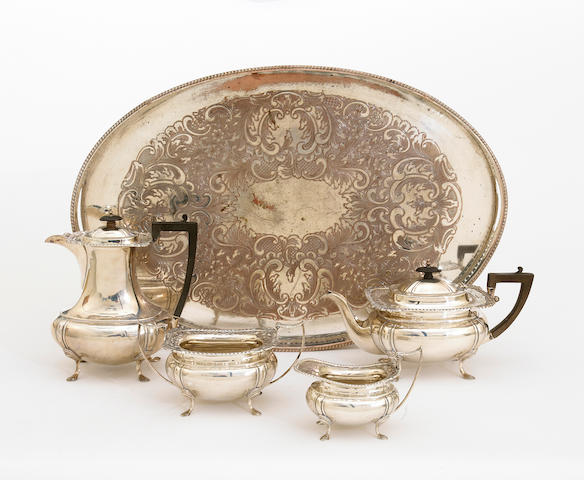A George V silver four piece tea set with wooden fittings in the Georgian taste with an associated silver plate on copper oval galleried tray by James Deakin & Sons, Sheffield, 1918  # H7813  (5)