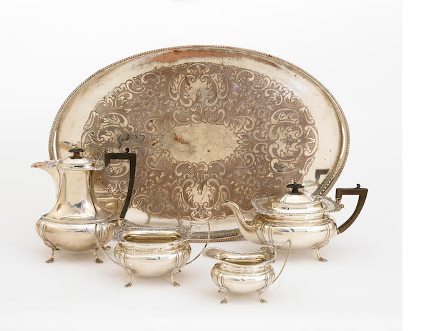 A George V silver four piece tea set with wooden fittings in the Georgian taste with an associated silver plate on copper oval galleried tray by James Deakin & Sons, Sheffield, 1918 <BR /># H7813  (5)