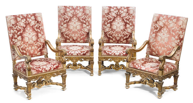 A set of four Régence style giltwood fauteuils