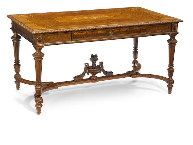 A Louis XVI style parcel gilt and parquetry inlaid walnut center table