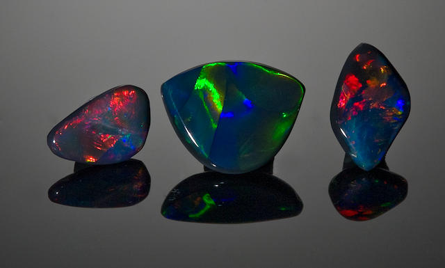 Three black opals: blue-green black opal, 5.75 cts; free form, 3.50 cts; and free form opal, 1.96 cts.