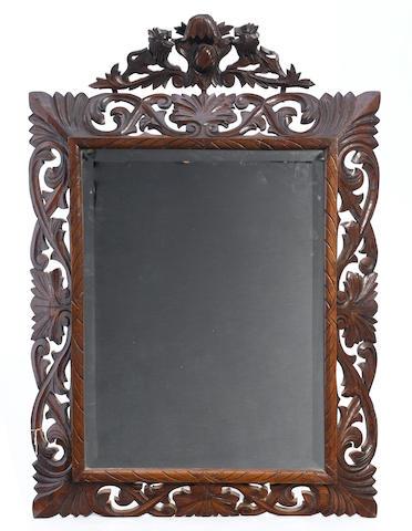 A Baroque style oak mirror
