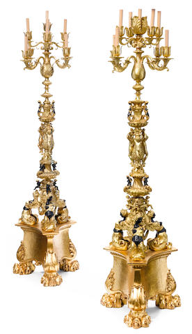 A near pair of Renaissance Revival gilt and patinated bronze and carved giltwood nine light floor torchères