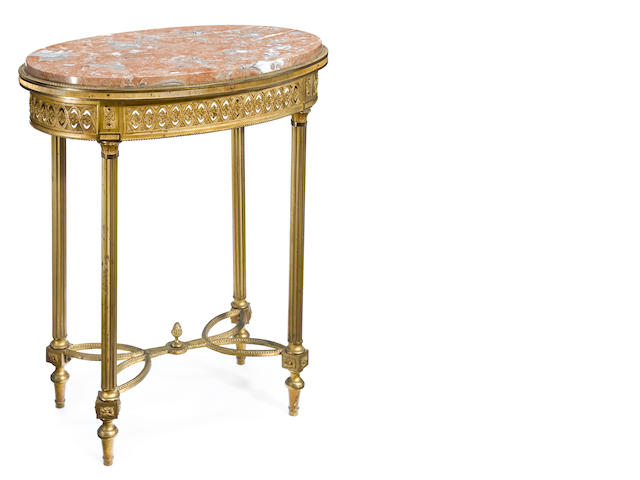 A Louis XVI style gilt bronze mounted oval table