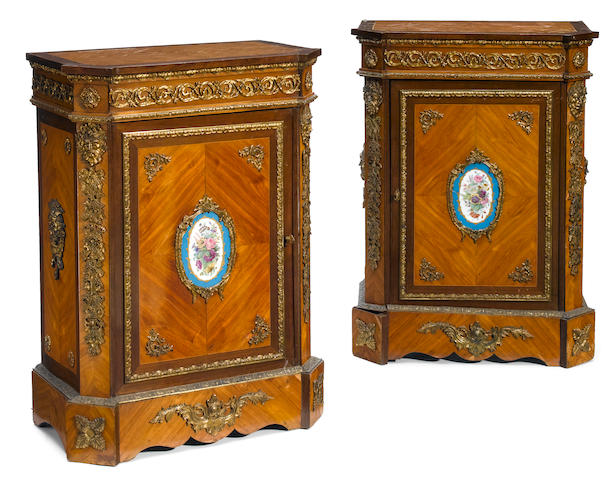 A pair of French gilt bronze and porcelain mounted walnut side cupboards  late 19th century