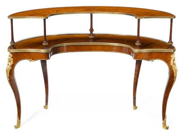 A Louis XV style gilt bronze mounted mahogany dessert table <BR />Henri Dasson