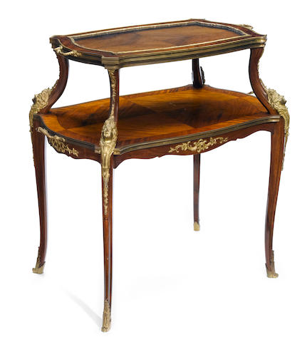 A French gilt bronze mounted two tier table