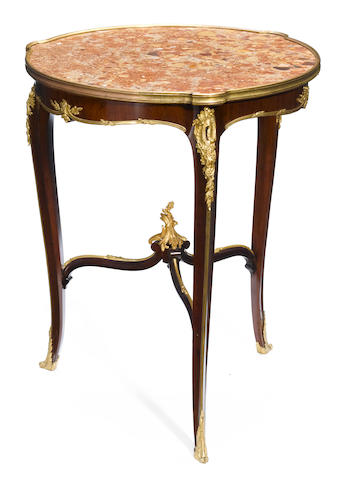 A Louis XV style gilt bronze mounted gueridon <BR />François Linke