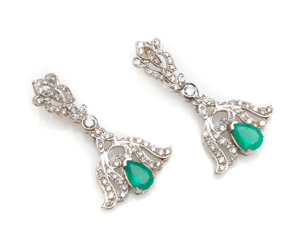 A pair of diamond, emerald and white gold pendant earrings