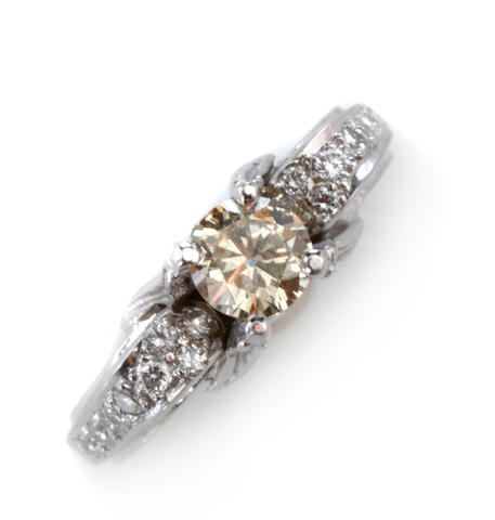 A colored diamond, diamond and platinum ring