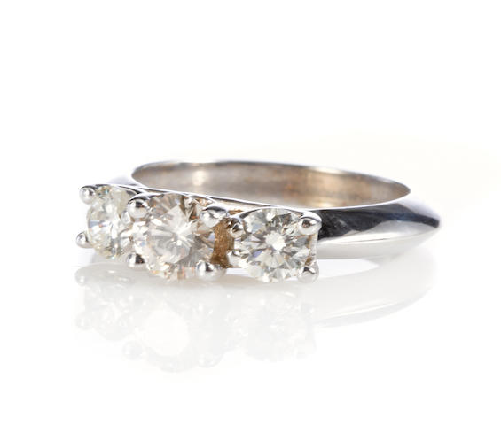 A diamond and white gold three stone ring