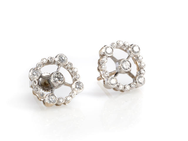 A pair of diamond and white gold circular earrings