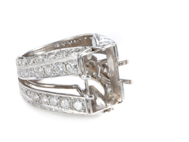 A diamond and white gold mounting
