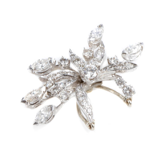 A diamond and platinum pendant enhancer