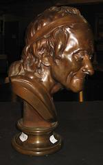 A French patinated bronze portrait bust of François- Marie Arouet (1694 – 1778) known as Voltaire <BR />after a model by Jean-Antoine Houdon (French, 1741- 1828)<BR />F. Barbedienne foundry<BR />late 19th/early 20th century