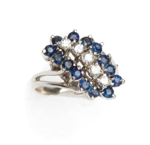 A blue stone and 14k white gold ring