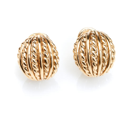 A pair of 14k gold earclips,