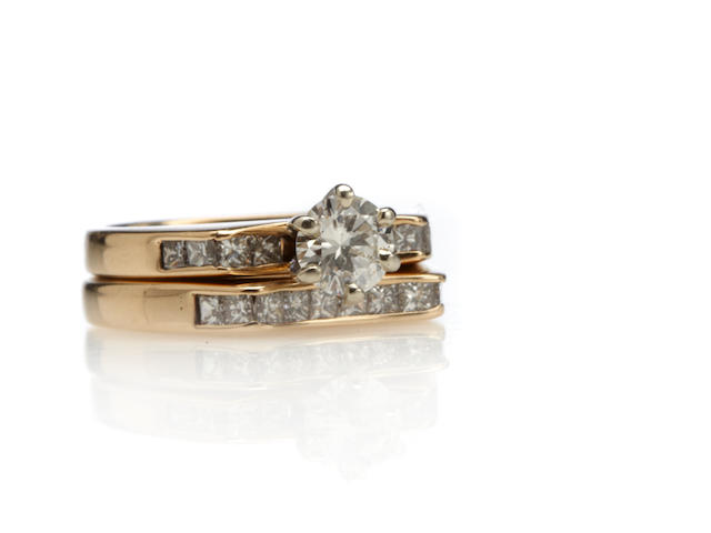 A diamond and 14k gold ring and matching band