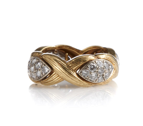 A diamond and bicolor gold ring