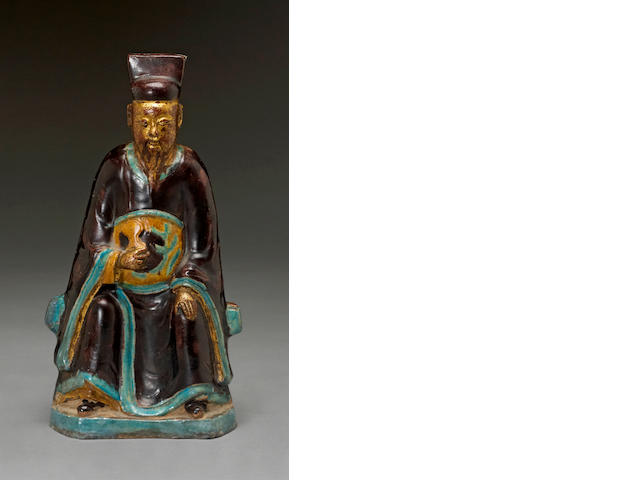 A three-color glazed potttery figure of a Doaist divinity Ming dynasty