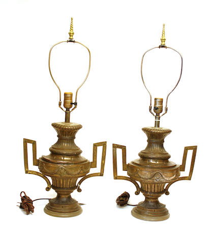 A pair of Italian Neoclassical silvered copper and wood two handled urns, now as lamps early 19th century and later