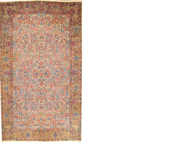A Kerman carpet Central Persia size approximately 11ft. 6in. x 20ft. 4in.